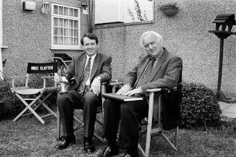 Actors Kevin Wheatley and John Thaw take a break from filming Inspector Morse. London, 1993.