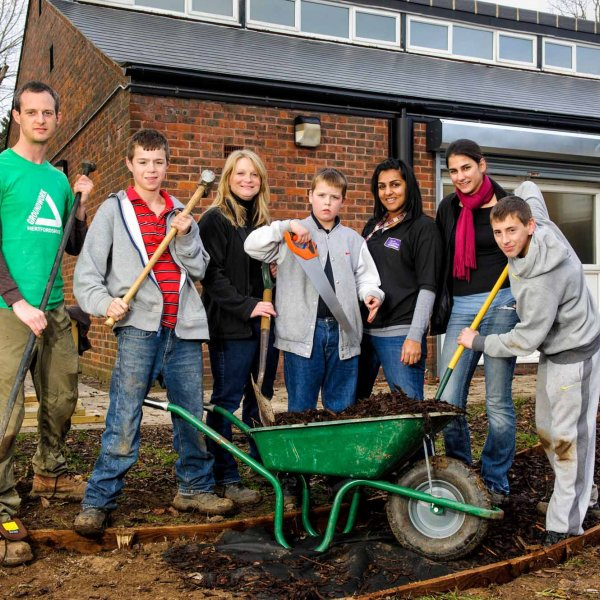 path 008  © Licensed to simonjacobs.com. 08/12/2012 Borehamwood, UK. Borehamwood. Youth workers at Affinity Sutton Farriers Hall building a bench and a pathway. L to R: Chris Dungate, Dylan Aldrich  16, Sarah Parkhouse, Tyler Aldrich 13, Manju Inagal, Alyannah Miller and Harry Mockett 14.